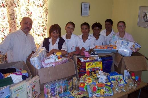 Helping Hand, Cape Town: Anthony Kristina and Sarah with donated toys and education materials