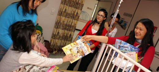 Family_volunteers_distributing_sponsored_Activated_mags_to_children_in_hospital_Taiwan.jpg